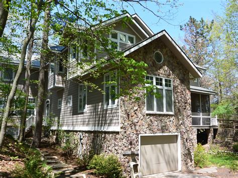 secluded cabin rentals in michigan lake mi with custom home homeaway