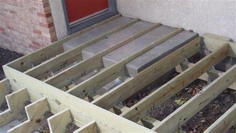Decks.com. Building a deck over concrete steps