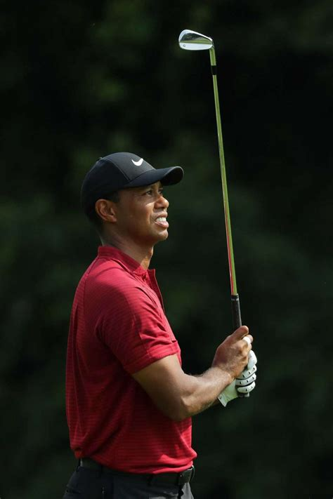 Tiger Woods teeters on edge of title in agonizing 2nd ...