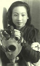 Asians wearing a gasmask
