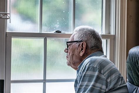 Royalty Free Lonely Old Man Staring Out Of A Window