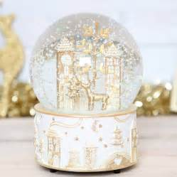 christmas wonderland musical snow globe by red berry apple notonthehighstreet com