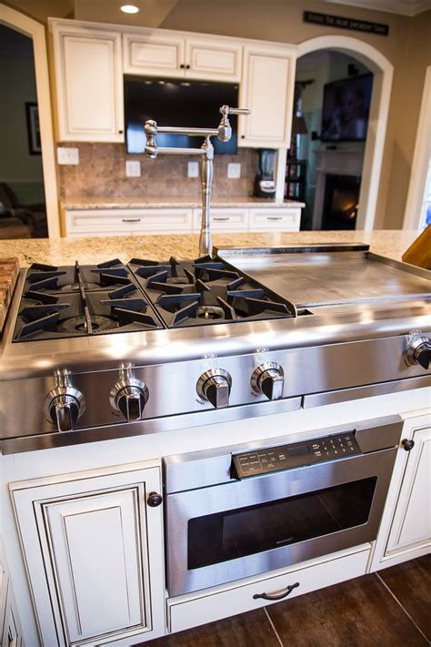 kitchen island with cooktop and seating this remarkable kitchen has maple cabinets with