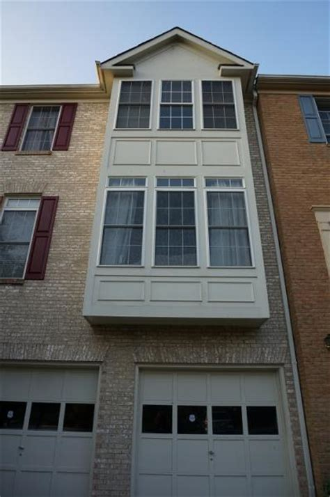 decorative story townhouse two story bay window in townhouse wood seems to be rotten