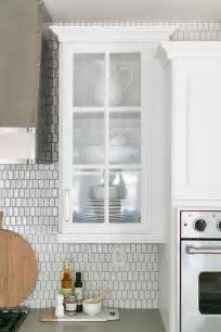 Gray Lacquered Kitchen Cabinets with White and Silver Oval