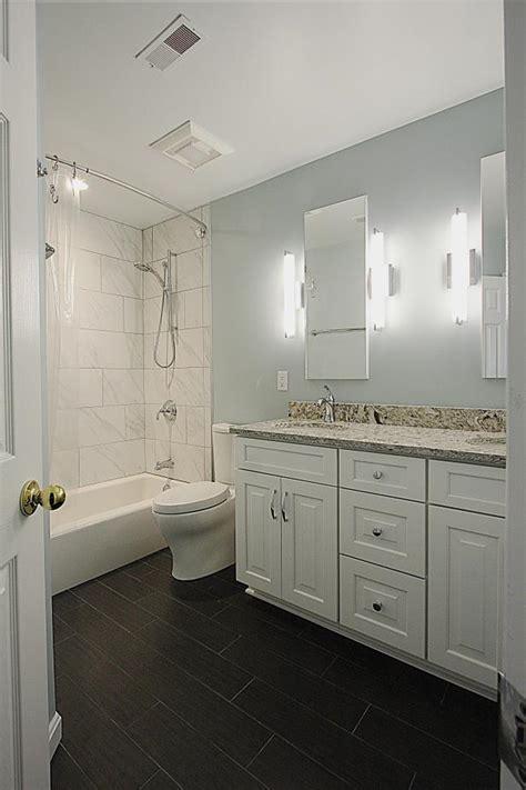 transitional bathroom  white vanity  black floor