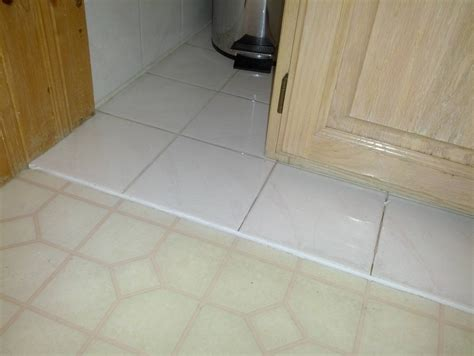 Can You Lay Vinyl Tile Linoleum by How Can I Level A Transition In A Floor Before Gluing A