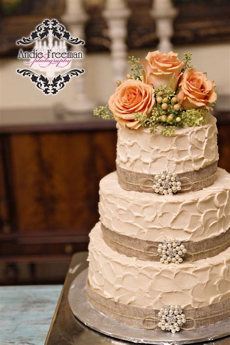 Three Tiered Rustic Wedding Cake Wrapped In Burlap With