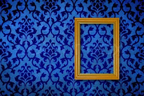 gold frame   vintage blue wall background stock photo