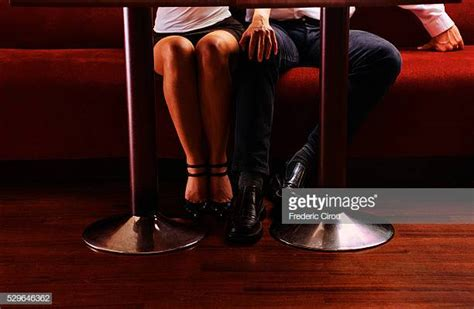 Man Touching Womans Leg Stock Photos And Pictures