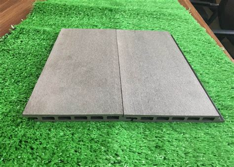 green plastic composite timber cladding panels siding panel wood grain surface