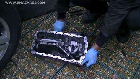 remove  oil sump pan clean oil pick  strainer