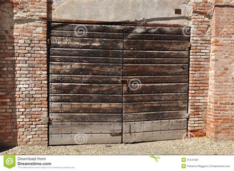 brick wall with gate old wooden gate and brick wall stock image image 31241301