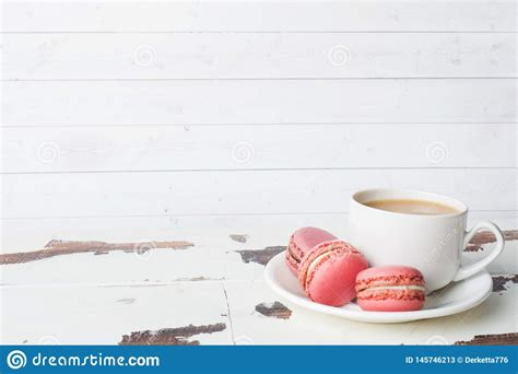 Choose from 4300+ cookies graphic resources and download in the form of png, eps, ai or psd. Cup Of Coffee And Macaroon Cookies On A Plate On A White Background. Copy Space Stock Image ...
