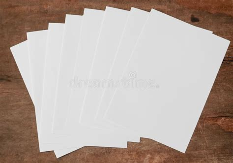 sheet white paper set  wood background mock ups paper