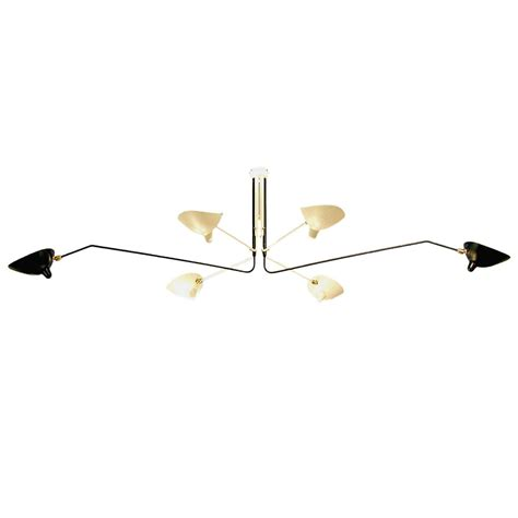 serge mouille chandelier ceiling l with six rotating arms in black and white by