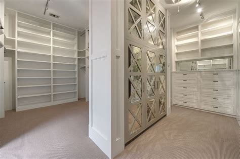 walk in closet with mirrored cabinets transitional closet