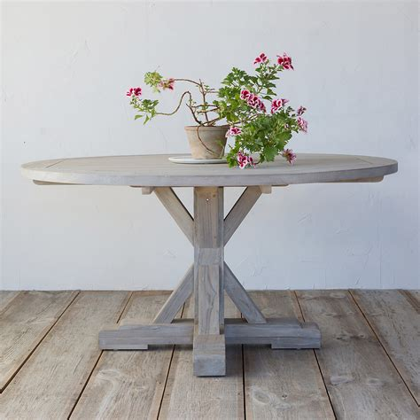 round wooden outdoor table 10 easy pieces round wood outdoor dining tables gardenista