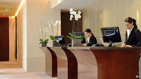 hotel front desk clerk hold the front desk hotels of the future