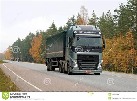 new volvo semi truck green volvo fh semi truck on the road in autumn editorial