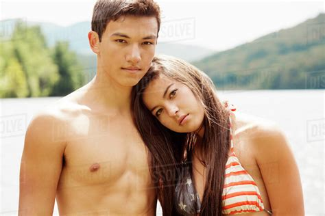 Portrait of teen couple          girl in bikini standing