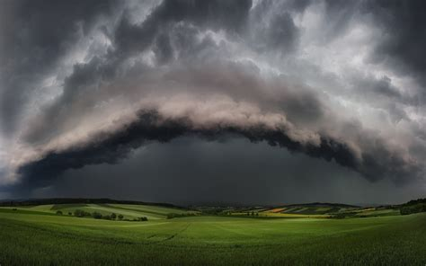 nature landscape supercell storm clouds field hill