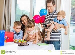 Family Celebrating Birthday Party At Home Stock Photo ...