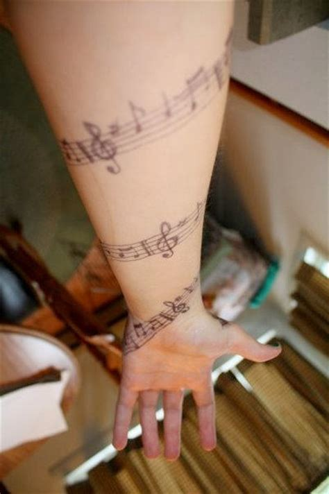 musical tattoo  arms