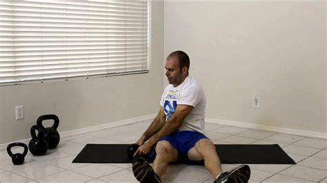 kettlebell seated oblique swing