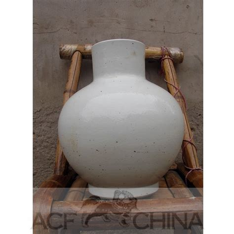 Glazed white ware porcelain vase with narrow mouth.