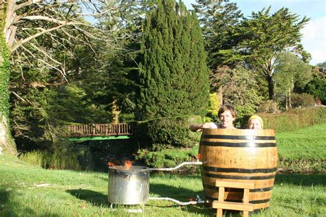 wine barrel tub wood fired whiskey barrel tub 3 500 00 via etsy