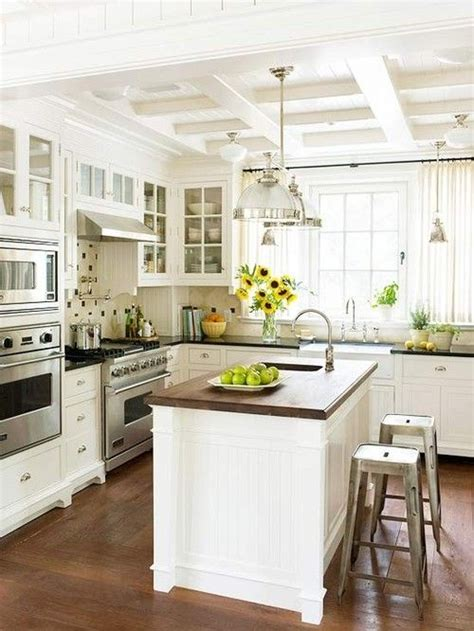 kitchens with an island coffered ceilings might be a way to hide beam for 6599
