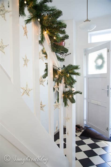 stairwell christmas garland lighting finally i a staircase garland songbird