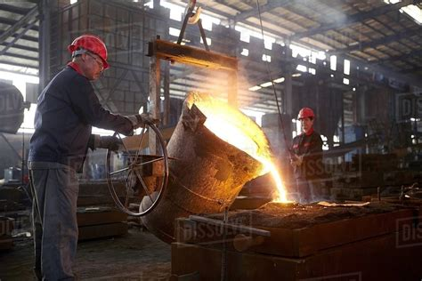 Working in cast iron foundry - Stock Photo - Dissolve