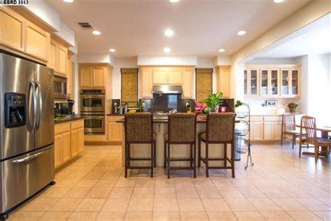 white tile backsplash help us tone oak color of cabinets by