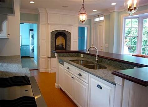 white kitchen with backsplash white kitchen with fireplace and granite countertop 1842