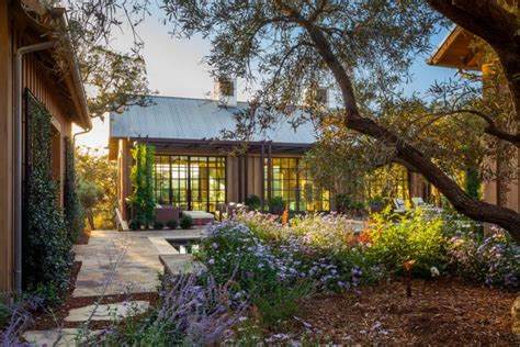 Backyard Paradise Landscaping by 15 Beautiful Transitional Landscape Designs For A