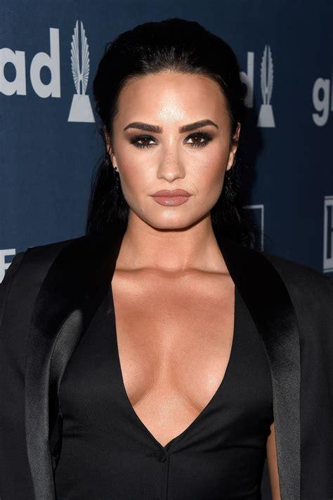 demetria devonne lovato swimsuit demi lovato sparks boob job rumours as pop star shares