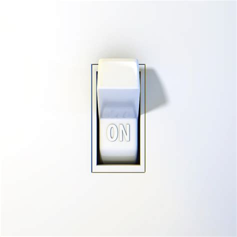 up of a wall light switch in the on position by