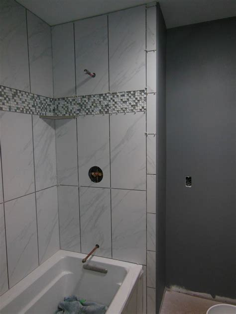 marble  tile tub surround bathroom