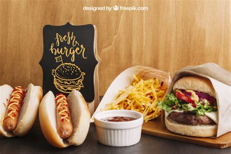 This table tent mockup is perfect for a fast food restaurant or diner. Fast food mockup with hot dogs and hamburger PSD file ...