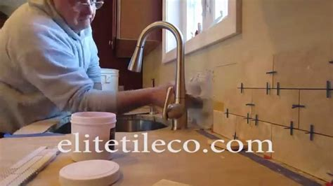 Time lapse Travertine subway tile backsplash with a mosaic