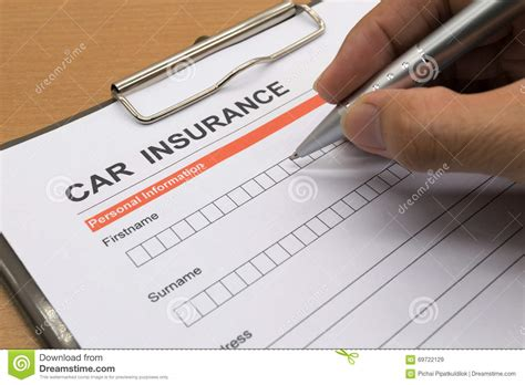 Man Signing A Car Insurance Policy Stock Photo - Image