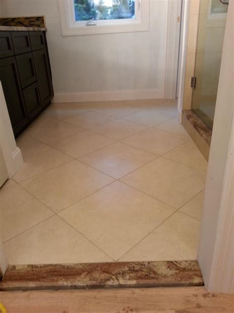 "Bathroom main floor, 18""x18"" Porcelain tile installed w/ 1"