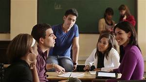 Young people at school, group of college students talking ...
