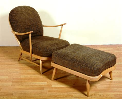 An Ercol Windsor Style Low Armchair And Footstool, With