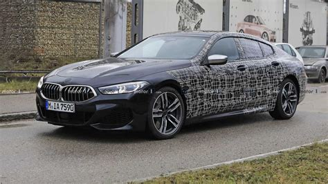 bmw 8 series gran coupe m850i sheds more camo in new spy shots