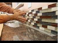 cutting glass tile backsplash How to Install a Glass Tile Backsplash | This Old House ...