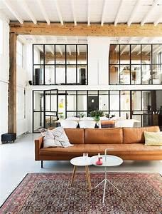 Verriere style atelier dans un loft renove for Tapis oriental avec entretien canapé en cuir