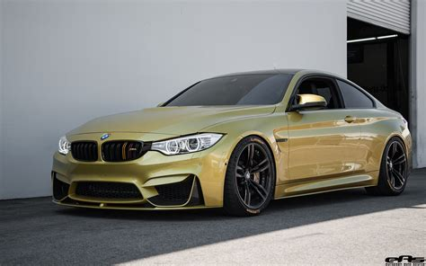 yellow bmw m4 build with a clean aftermarket